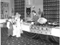Skyline Club, Burtonwood, Childrens Halloween Part 1958, Shirley Makin, Ass club Director serving toffee apples
